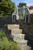 Steps in sea wall at Bosham. Sussex. England Royalty Free Stock Photo