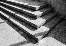 Steps in Shadow. Stone steps shown at an angle to form nice shadows and rectangular composition royalty free stock photography