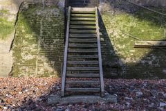 Thames Shore Steps. Steps from the shore of the River Thames that lead up to the Thames Path in London, UK royalty free stock photo