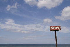 Steps sign on Sea front Stock Photography