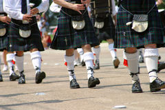 Steps and Skirts. An Irish musical group marches in the Plano, Texas, Fourth of July parade in 2003 Royalty Free Stock Image