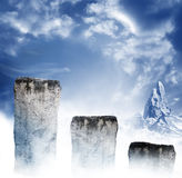 Steps into sky. Rock pedestals into the blue sky with mountains in the background.  Concept for reaching a goal Stock Photo