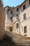 Steps between small alley in historical village in Marche Stock Photo