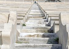 Steps on the stadium of white marble in Athens, Panathinaikos Stadium. Pass for spectators in the arena of the Olympic Games in Athens, Greece stock photo