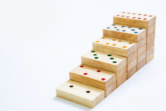 Steps or stair of  wooden domino on white background and copy sp Stock Images