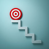 Steps or stairs with goal target or red dart board on top the business concept over light green Royalty Free Stock Image