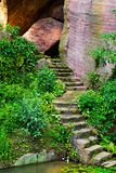 Steps from the Stones. This image is of some steps and surrounding area. The image has large stones, green vegetation. the steps lead down to the lake, where Royalty Free Stock Photos