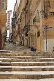 Steps and street in Valletta, Malta. Typical street with steps in Valletta, Malta Triq Sant` Orsla Stock Photo