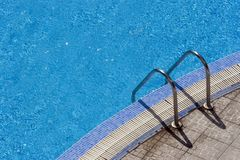 Steps swimming pool. Steps into hotel swimming pool stock photo