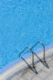 Steps into swimming pool. Steps into hotel swimming pool royalty free stock images