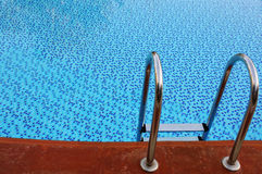 The steps into a swimming pool Stock Photography