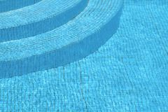 Steps of the swimming pool Stock Images