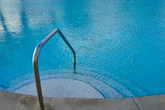 Steps into swimming pool Stock Photos