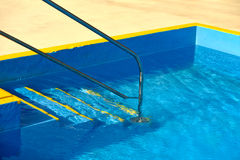 Steps into a swimming pool - detail Stock Image