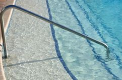 Steps into swimming pool Royalty Free Stock Images