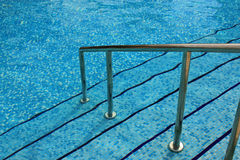 Steps into a swimming pool Stock Photo