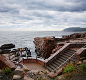 Steps At Thunder Hole. A Stairway And Overlook Along The Rocky Acadia Seacoast On A Rainy And Stormy Day At Thunder Hole, Acadia National Park, Maine, USA Stock Photos