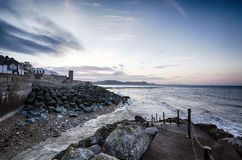 Daybreak At Lyme Regis. Steps to the beach at Lyme Regis, part of Dorset's Jurassic Coast Royalty Free Stock Photos