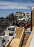 Steps to cafe and the town of Fira, Santorini Royalty Free Stock Photography
