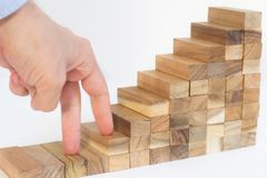 Steps to career success. Fingers walking on wooden block steps, business success concept Stock Images
