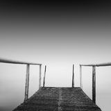Steps to nowhere. Beautiful minimalistic black and white seascape with stairs into the sea and milk water. shot taken in daytime with long exposure. black sea Stock Photos