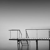 Steps to nowhere. Beautiful minimalistic black and white seascape with stairs into the sea and milk water. shot taken in daytime with long exposure. black sea Royalty Free Stock Photo