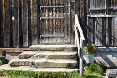 Steps to old wooden door Stock Image