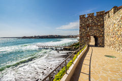 Steps to the rocky shore from the old town. Ancient european city Sozopol on a rocky shore near sea in summer. piere and steps to sea shore Stock Photos