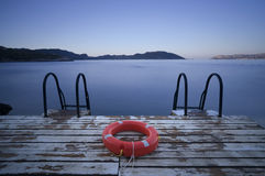 Steps to sea and Lifebuoy Royalty Free Stock Photos