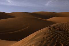 Steps to walk in the desert on the fine sand royalty free stock image