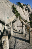 Steps trail mountainside. Stone steps and switchback trail up a steep, rugged mountain Royalty Free Stock Photography