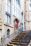 Steps Up to Red Door in Church Stock Photography