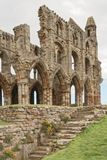 Whitby abbey ruin, yorkshire, uk. The steps up to Whitby Abbey in Yorkshire, famous for providing inspiration for Bram Stoker`s Dracula on an overcast day in Stock Photo