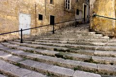 Steps in Valletta, Malta. Steep stone steps in the historic capital of Valletta, Malta, connect one street to another. When the city was built in the mid-1500' Royalty Free Stock Photos