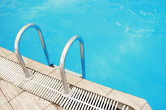 Steps in a water pool Stock Images