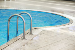 Steps in a water pool Royalty Free Stock Photos