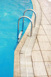Steps in a water pool Stock Photography