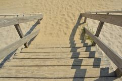 Steps. Wooden steps leading to a sandy beach Stock Photos