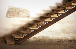 Steps. Wooden stairs up and old ragged wall Royalty Free Stock Photo