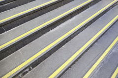 Steps with yellow signs. Detail of stairs with protective signals Stock Photography