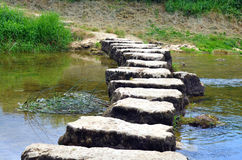 Stepstones crossing a small river Royalty Free Stock Photos