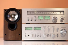 Stereo amplifier, radio tuner, loudspeakers. Stereo hifi system with amplifier, radio tuner and loudspeakers stock images