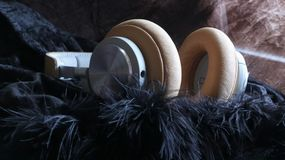 Stereo Bass Over ear Headphones. Hifi Music Wireless Stereo luxury headphones on a soft furry material stock images
