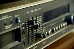 Stereo Closeup. A closeup of a 1970's era black stereo focused mostly on the bass lever, which is raised to the top Stock Images