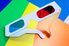 Stereo glasses. Stereo glasses for viewing anaglyph images on a colorful background stock photo
