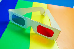 Stereo glasses. Stereo glasses for viewing anaglyph images on a colorful background stock image