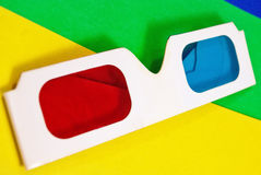 Stereo glasses. Stereo glasses for viewing anaglyph images on a colorful background stock photography