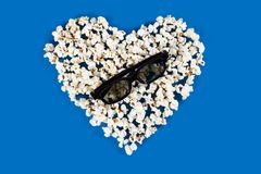 Stereo glasses lie on the heart of popcorn Stock Photography