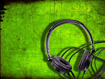 Stereo headphones. Black stereo headphones on dirty green background Stock Photo