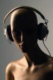 Stereo headphones. A dummy head with stereo headphones stock photos